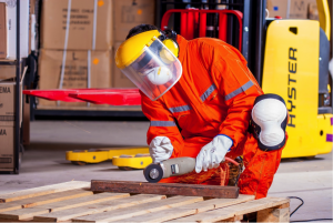 A worker wearing safety gear in an industrial setting